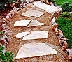 CODE 7: Garden path, with Aris stone on the sides, paved with small pebble and steps from multiangled beige plate
